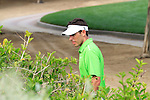 Charl Schwartzel has to search for his ball in the bushes after driving off on the 13th hole during Day 3 Saturday of the Abu Dhabi HSBC Golf Championship, 22nd January 2011..(Picture Eoin Clarke/www.golffile.ie)