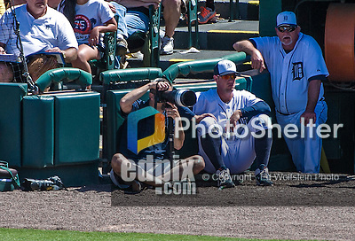 14 March 2014: Detroit Tigers Team Photographer Mark Cunningham works aside the dugout during a Spring Training Game against the Washington Nationals at Joker Marchant Stadium in Lakeland, Florida. The Tigers defeated the Nationals 12-6 in Grapefruit League play. Mandatory Credit: Ed Wolfstein Photo *** RAW (NEF) Image File Available ***