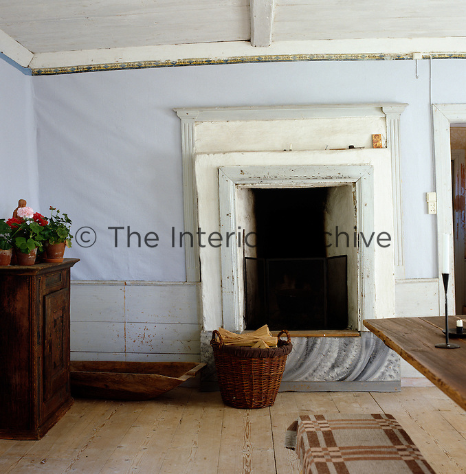 A simple rustic fireplace at one end of the dining room