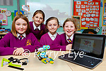 Two Mile Ns pupils l-r: Leah Harris, Kate Kissane, Ella Mai Cronin, and Holly Culloty building a robot in science class