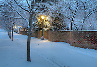 The University of Virginia serpentine walls in snow on central grounds.