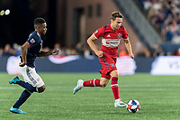 FOXBOROUGH, MA - AUGUST 25: Przemyslaw Frankowski #11 of Chicago Fire on the attack during a game between Chicago Fire and New England Revolution at Gillette Stadium on August 24, 2019 in Foxborough, Massachusetts.