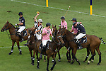 Mint Polo in the Park. Hurlingham Park Fulham London Uk June 6th 2010. Yellow card for IG Index Team Paris player (in pink). Jack Kidd hurt during play wearing number 1 blue shirt City AM Team New York