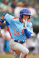 Tennessee Smokies outfielder Jacob Hannemann (19) runs to first during a game against the Montgomery Biscuits on May 25, 2015 at Riverwalk Stadium in Montgomery, Alabama.  Tennessee defeated Montgomery 6-3 as the game was called after eight innings due to rain.  (Mike Janes/Four Seam Images)