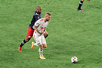 FOXBOROUGH, MA - MAY 22: Thomas Edwards #7 of New York Red Bulls brings the ball forward as Andrew Farrell #2 of New England Revolution closes during a game between New York Red Bulls and New England Revolution at Gillette Stadium on May 22, 2021 in Foxborough, Massachusetts.