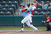 Yu Chang (6) of the Columbus Clippers follows through on his swing against the Indianapolis Indians at Huntington Park on June 17, 2018 in Columbus, Ohio. The Indians defeated the Clippers 6-3.  (Brian Westerholt/Four Seam Images)