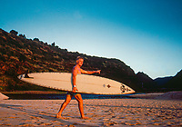 Pipeline, North Shore, Oahu, Hawaii. Cheyne Horan (AUS) walking out for a surf session at Wiamea Bay. Horan had finished =3rd in the event Marui Pipeline Masters and won the Billabong Pro Hawaii at Sunset Beach in the North Shore Winter surf season of 1989-1990. Photo:joliphotos