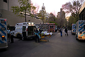 April 12, 2020<br /> New York, New York<br /> <br /> Police, ambulance drivers, medical workers, patients and pedestrians mix in front of Mount Sini Beth Israel Hospital during the height of the city's coronavirus pandemic. More than 10,000 deaths have been reported in the state.