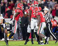 ATHENS, GA - NOVEMBER 09: Quay Walker #25, Adam Anderson #19 and Azeez Ojulari #13 of the Georgia Bulldogs celebrate a sack by Walker during a game between Missouri Tigers and Georgia Bulldogs at Sanford Stadium on November 09, 2019 in Athens, Georgia.