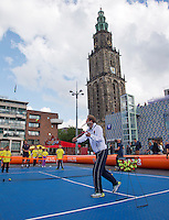 11-sept.-2013,Netherlands, Groningen,  Martini Plaza, Tennis, DavisCup Netherlands-Austria, Draw,   Street tennis on the market squire with Thiemo de Bakker(NED)<br /> Photo: Henk Koster