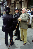 A farmer talks with policemen during a march in London organised by the Countryside Alliance to protest at a proposed ban on hunting with dogs.