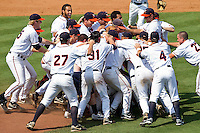 The Virginia Cavaliers celebrate on the field after they defeated the Florida State Seminoles 7-2 to win the Championship Game of the 2011 ACC Baseball Tournament at the Durham Bulls Athletic Park on May 29, 2011 in Durham, North Carolina.  Photo by Brian Westerholt / Four Seam Images