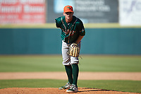 Greensboro Grasshoppers relief pitcher John O'Reilly (31) looks to his catcher for the sign against the Hickory Crawdads at L.P. Frans Stadium on May 26, 2019 in Hickory, North Carolina. The Crawdads defeated the Grasshoppers 10-8. (Brian Westerholt/Four Seam Images)