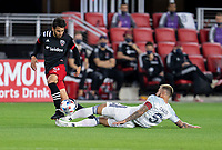 WASHINGTON, DC - MAY 13: Adrien Perez #16 of D.C. United moves through the tackle of Francisco Calvo #5 of Chicago Fire FC during a game between Chicago Fire FC and D.C. United at Audi FIeld on May 13, 2021 in Washington, DC.