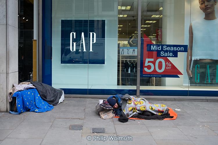 Rough leepers outside a Gap store, Moorgate, Islington, London.