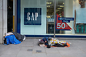 Rough leepers outside a Gap store, Moorgate, Islington, London.
