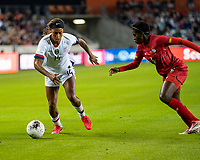 HOUSTON, TX - JANUARY 31: Jessica McDonald #14 of the USA attacks with the ball against Maria Murillo #6 of Panama during a game between Panama and USWNT at BBVA Stadium on January 31, 2020 in Houston, Texas.