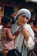 """Calcutta, India. April 04, 1975.<br /> Mother Teresa in her orphanage spending time with each kid. She takes long hours in the morning to talk and confront them. Mother Teresa (Agnes Gonxha Boyaxihu) the Roman Catholic, Albanian nun revered as India's """"Saint of the Slums,"""" was awarded the 1979 Nobel Peace Prize."""