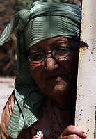 "Palestinian woman look at funeral two Palestinian children were killed in Gaza August 7, 2007. A rocket fired at Israel by Palestinian militants on Tuesday fell short and killed two Palestinian children in the Gaza Strip, ambulance crews said.""photo by Fady Adwan"""