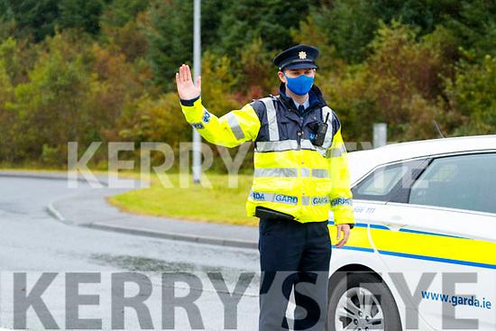 Garda Alan Clerkin on duty at a checkpoint near Castleisland on Wednesday.