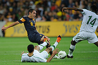 Mark MILLIGAN (8) of Australia and Saud KARIRI (14) of Saudi Arabia fight for the ball during the FIFA 2014 World Cup Group D Asian Qualifier match between Australia and Saudi Arabia at AAMI Park in Melbourne, Australia...This image is not for sale on this web site. Please contact Southcreek Global Media for licensing:.Toll Free: 1.800.934.5030.Canada: 701 Rossland Rd. East, Suite 315, Whitby, Ontario, Canada, L1N 9K3.USA: 10792 Baron Dr, Parma OH, USA 44130.Web: http://southcreekglobal.net/ and http://southcreekglobal.com/