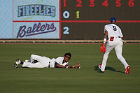 Kannapolis Cannon Ballers right fielder Caberea Weaver (9) makes a sliding attempt to catch a fly ball during the game against the Columbia Fireflies at Atrium Health Ballpark on May 21, 2021 in Kannapolis, North Carolina. (Brian Westerholt/Four Seam Images)