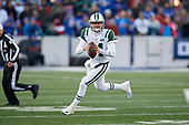 New York Jets quarterback Sam Darnold (14) looks to pass while scrambling during an NFL football game against the Buffalo Bills, Sunday, December 9, 2018, in Orchard Park, N.Y.  (Mike Janes Photography)
