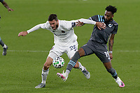 ST PAUL, MN - NOVEMBER 4: Elliot Collier #28 of Chicago Fire FC and Romain Metanire #19 of Minnesota United FC battle for the ball during a game between Chicago Fire and Minnesota United FC at Allianz Field on November 4, 2020 in St Paul, Minnesota.