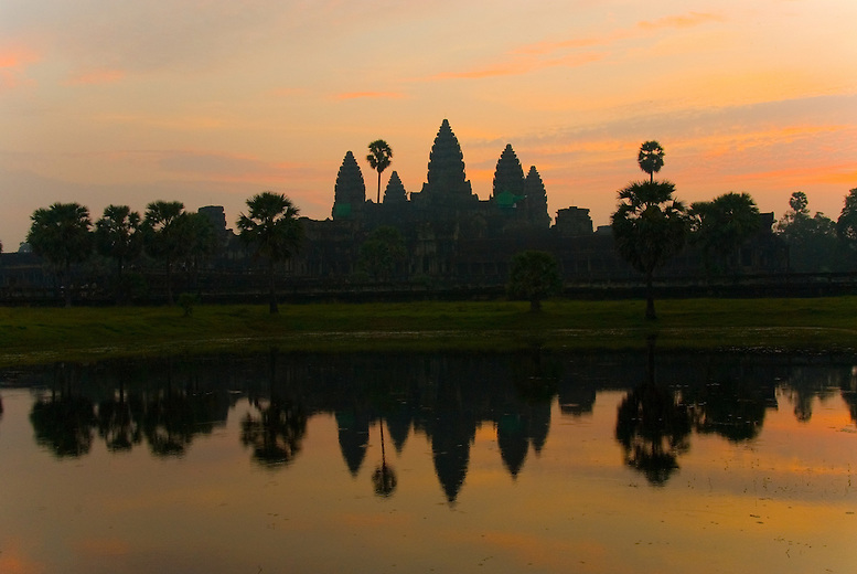 Angkor Wat, generally agreed by historians that it represents the apex of Khmer architectural and sculptural genius. Perhaps one of the most beautiful scenes is watching the sun rise over Angkor Wat. Angkor Wat was built in the 12th century by King Suryavarman II and was originally dedicated to the Hindu god Vishnu, the protector of creation. The layout of Angkor Wat is based on mandala or sacred design of the Hindu cosmos, is a five towered temple shaped like a lotus bud and represents Mount Meru, the mythical abode of the gods and the centre of the universe. Unusual amongst Khmer temples, Angkor Wat faces west toward the setting sun, a symbol of death. Another theory for this western direction is simply that it was a better direction in relation to the town.