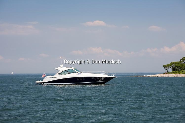 Power cruiser at anchor near island