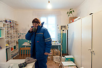 Olga, a medic working on an air ambulance, drinks a coffee during a quick break before travelling with a patient on the 2.5 hour flight back to Turukhansk hospital.