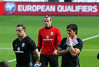 (L-R) Goalkeeping coach Tony Roberts, Gareth Bale and manager Chris Coleman gather for pre-training briefing during the Wales Press Conference and Training Session at The Cardiff City Stadium, Cardiff, Wales, UK. Friday 01 September 2017