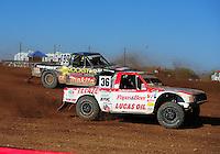 Apr 17, 2011; Surprise, AZ USA; LOORRS driver Rodrigo Ampudia (36) leads Kyle Leduc (99) during round 4 at Speedworld Off Road Park. Mandatory Credit: Mark J. Rebilas-