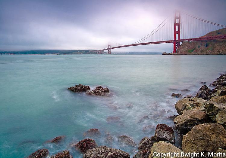 Mist-shrouded Golden Gate Bridge on view from the Presidio Yacht Club in Marin near Sausalito, California