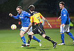 Partick Thistle v St Johnstone....21.01.14   SPFL<br /> Lee Croft takes on Jordan McMillan<br /> Picture by Graeme Hart.<br /> Copyright Perthshire Picture Agency<br /> Tel: 01738 623350  Mobile: 07990 594431