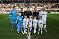 SWANSEA, WALES - FEBRUARY 07: Children mascots with team captains, Ashley Williams (R) of Swansea and match officials, Phil Down (C) before the Premier League match between Swansea City and Sunderland AFC at Liberty Stadium on February 7, 2015 in Swansea, Wales.