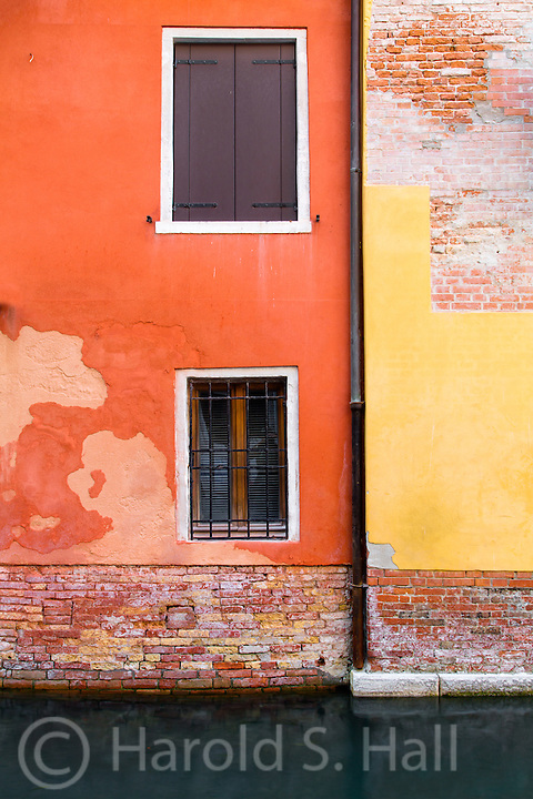 The canals of Venice are old and worn, but colorful.  Even where the plaster is falling off, the design contrast adds to the design.
