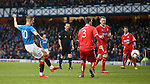 Dean Shiels curls in his opening goal for Rangers from out wide into the net