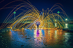 """Pictured:  Southend on Sea, seafront<br /> <br /> Amazing photos show sparks illuminating British landmarks as they fly from what appears to be a disc of colourful light.  This unique effect is the result of long-exposure night-time shots of a whisk stuffed with steel wool, which is set alight and spun at the end of a metal chain.<br /> <br /> Amateur photographer Dmitrij Dimek is passionate about what he calls 'light paintings', and took these photos at castles, beaches and other settings around Essex and London.  The 38 year old, who grew up in Poland but now lives in Southend-on-Sea, Essex, said: """"When I first found out about light painting with steel wool, I thought it was an outstanding way to connect with photography.  SEE OUR COPY FOR DETAILS.<br /> <br /> Please byline: Dmitrij Dimek/Solent News<br /> <br /> © Dmitrij Dimek/Solent News & Photo Agency<br /> UK +44 (0) 2380 458800"""