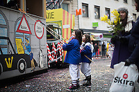 Children use long poles connected to sieves as they await goodies during a procession or Cortège, on the first day of Fasnacht, the Carnival of Basel in Switzerland. Feb. 23, 2015.