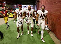 LOS ANGELES, CA - SEPTEMBER 11: Jacob Mangum-Farrar #14, Ricky Miezan #45 and Jordan Fox #10 of the Stanford Cardinal walk to the locker room after a game between University of Southern California and Stanford Football at Los Angeles Memorial Coliseum on September 11, 2021 in Los Angeles, California.