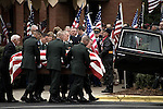 December 21, 2007. Charlotte, NC.. A funeral was held for Cpl. Joshua C. Blaney in Charlotte, NC. Cpl. Blaney died on December 12 from injuries sustained when an IED exploded near his vehicle in Afghanistan. He was 25.. Cpl. Blaney's coffin is loaded into a hearse headed for the cemetery after services at Cedar Grove Baptist Church. Members of the patriot Guard, a motorcycle group founded to protect the funerals of fallen soldiers from protesters, line the sidewalk.