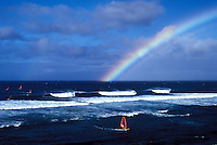 Windsurfer at Hookipa Beach, Maui with a rainbow in the background.