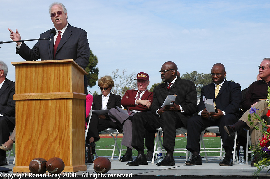 Bill Settles addresses the crowd during a Memorial service held for Coach Bennie Eden at the Point Loma High School Football stadium that was recently renamed in his honor, Saturday February 23 2008.
