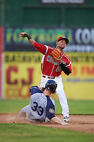 Batavia Muckdogs second baseman Rony Cabrera (26) throws to first as Dan Rizzie (33) slides into second during a game against the Brooklyn Cyclones on July 5, 2016 at Dwyer Stadium in Batavia, New York.  Brooklyn defeated Batavia 5-1.  (Mike Janes/Four Seam Images)