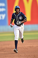 Asheville Tourists first baseman Correlle Prime #32 rounds the bases after hitting a home run during a game against the Charleston RiverDogs at McCormick Field July 26, 2014 in Asheville, North Carolina. The RiverDogs defeated the Tourists 8-7. (Tony Farlow/Four Seam Images)