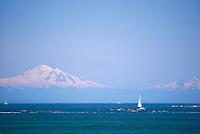 Ocean Kayaking and Sailing in Howe Sound, near Vancouver, British Columbia, Canada - Mount Baker, Washington State, USA, rises above horizon