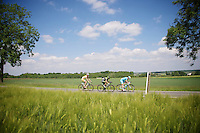 breakaway group: Sebastien Delfosse (BEL/Wallonie-Bruxelles), Serge Dewortelaer (BEL/Veranclassic-Doltcini) & Evan Huffman (USA/Astana) racing through the sunny fields<br /> <br /> 2014 Belgium Tour<br /> stage 4: Lacs de l'Eau d'Heure - Lacs de l'Eau d'Heure (178km)