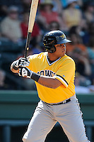 First baseman Edwin Espinal (14) of the West Virginia Power bats in a game against the Greenville Drive on Sunday, May 11, 2014, at Fluor Field at the West End in Greenville, South Carolina. Greenville won, 9-6. (Tom Priddy/Four Seam Images)