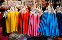 Chichicastenango, Guatemala.  Colored Candles Hanging in a Shop in the Market.